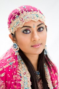 Beautiful Bengali bride in colorful dress isolated
